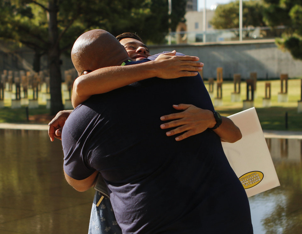 Photo -  David Sylvester, of Philadelphia, gives a hug to Keanu Sarrantino at the Oklahoma City National Memorial & Museum. [Photo by Jacob Derichsweiler, The Oklahoman]
