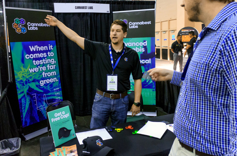 Photo - Daniel Sellers, of Cannabest Labs, tals to attendees during the Oklahoma City CannaCon at the Cox Convention Center in Oklahoma City, Okla. on Wednesday, April 17, 2019.   Photo by Chris Landsberger, The Oklahoman