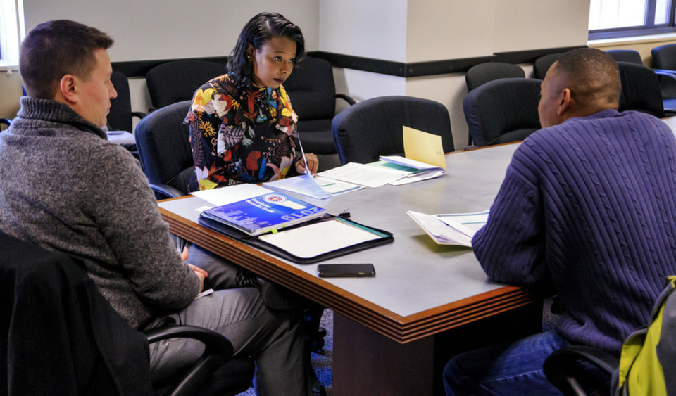 Photo - New Oklahoma City Ward 7 councilwoman Nikki Nice goes over paper work with Christian York, left, and Ziven Vaughn as she begins her new position on the city council at the City of Oklahoma City's City Council office in Oklahoma City, Okla. on Friday, Nov. 9, 2018. Photo by Chris Landsberger, The Oklahoman