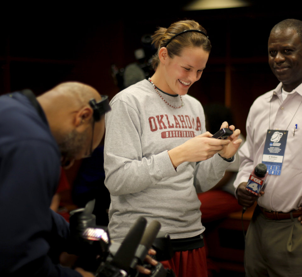 Photo - OU's Whitney Hand laughs in the locker room in Kansas City, Mo., on Monday, March 29, 2010. Oklahoma will play Kentucky in the regional championship game of the NCAA women's tournament on Tuesday, March 29, 2010.
