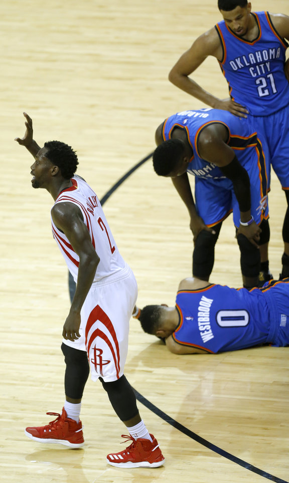 Photo - Houston's Patrick Beverley (2) argues a foul as Oklahoma City's Victor Oladipo (5) and Andre Roberson (21) help an injured Oklahoma City's Russell Westbrook (0) during Game 2 in the first round of the NBA playoffs between the Oklahoma City Thunder and the Houston Rockets in Houston, Texas,  Wednesday, April 19, 2017.  Photo by Sarah Phipps, The Oklahoman