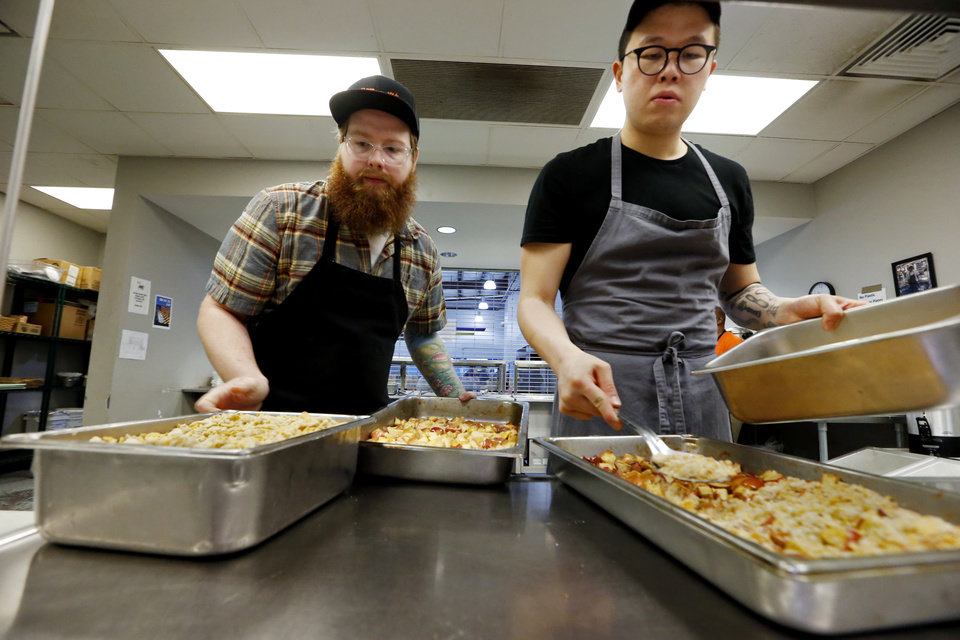 Photo -  Derek Forari and Paul Wang prepare cobbler at the Homeless Alliance when local chefs made lunch in April. [Photo by Steve Sisney, The Oklahoman]