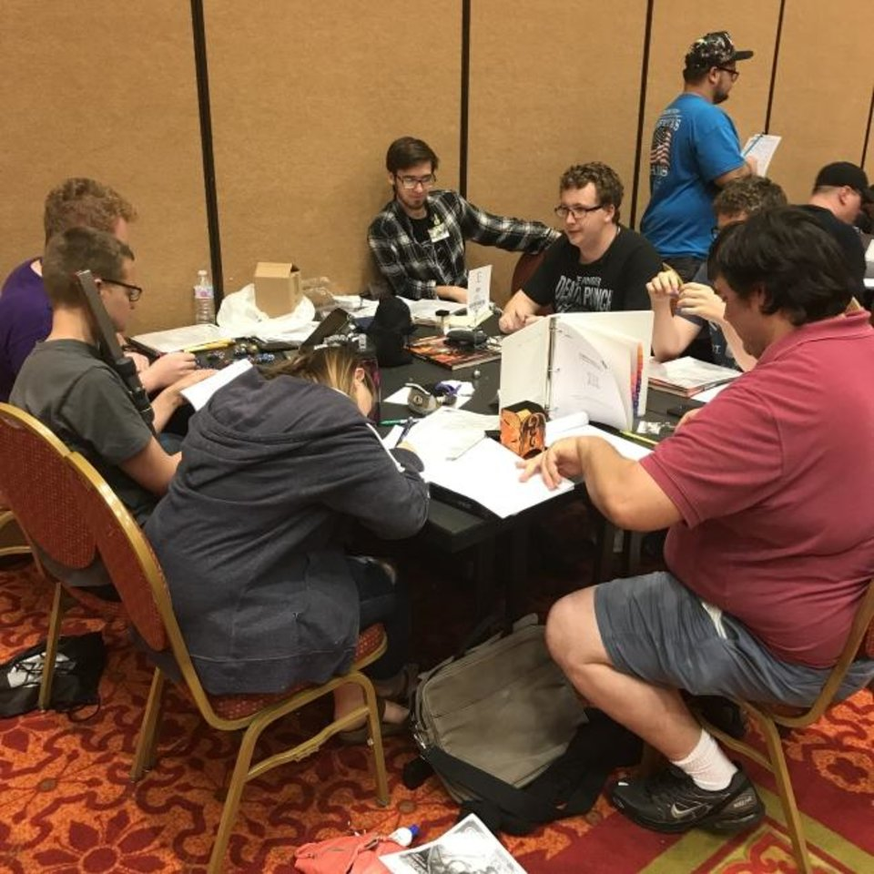 Photo -  The gaming room at SoonerCon featured a variety of tabletop games. [Matthew Price]