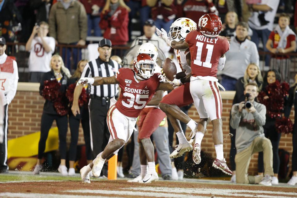 Photo - Oklahoma's Parnell Motley (11) intercepts a pass intended for Iowa State's La'Michael Pettway (7) during an NCAA football game between the University of Oklahoma Sooners (OU) and the Iowa State University Cyclones at Gaylord Family-Oklahoma Memorial Stadium in Norman, Okla., Saturday, Nov. 9, 2019. [Bryan Terry/The Oklahoman]