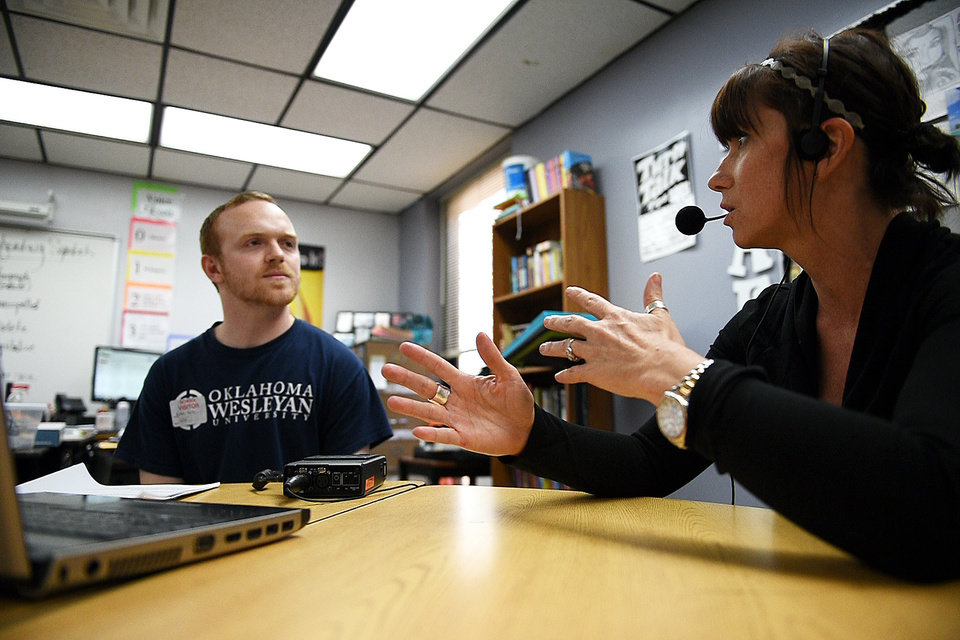 Photo - Researcher Nathan Horton interviews Shannon Kraft, a sixth-grade language arts and world studies teacher, about Oklahoma dialects March 26 at Stillwater Middle School .   Photo by Tyler Drabek, for The Oklahoman/ Design by Chris Schoelen, The Oklahoman Graphics  Tyler Drabek