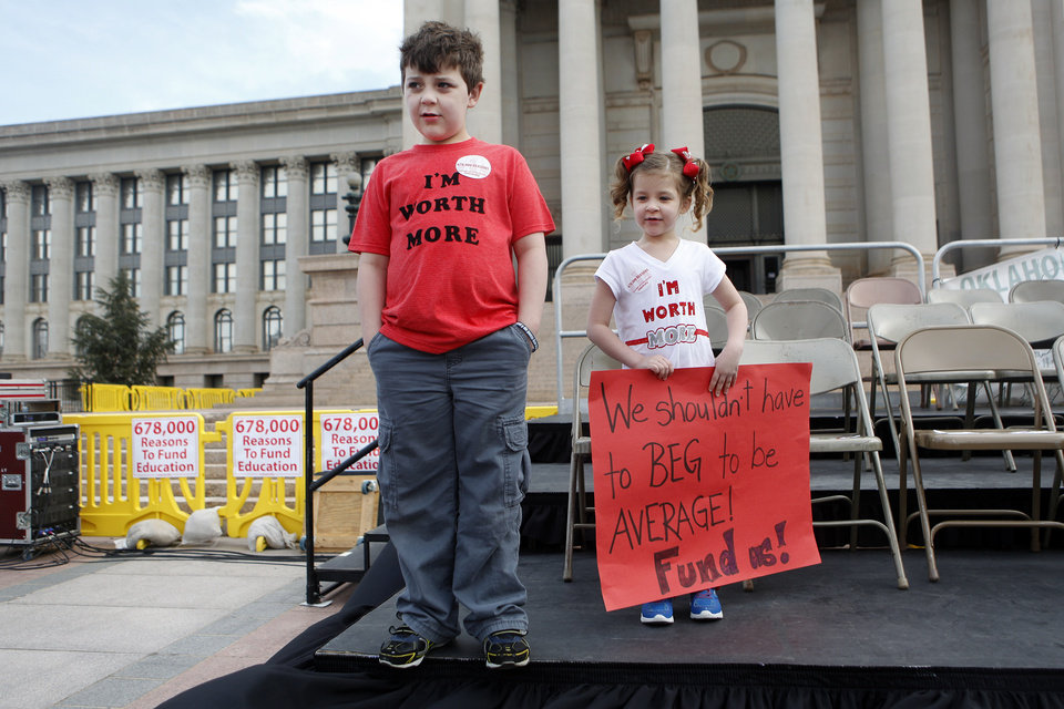 Photo - Collin and Kennedy Wright of Tulsa, stand on stage as they take part during a rally to appeal to lawmakers to make education funding a priority at the state capitol in Oklahoma City, Okla. on Monday, March 31, 2014. Educators, parents and community members from across Oklahoma gathered at the statehouse to make their voices heard by lawmakers. Photo by K.T. King, The Oklahoman