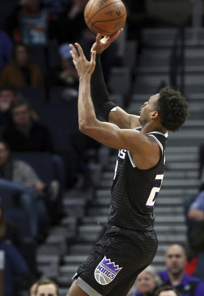 Photo - Sacramento Kings' Buddy Hield shoots against the Minnesota Timberwolves in the first half of an NBA basketball game Monday, Feb. 25, 2019, in Minneapolis. (AP Photo/Jim Mone)