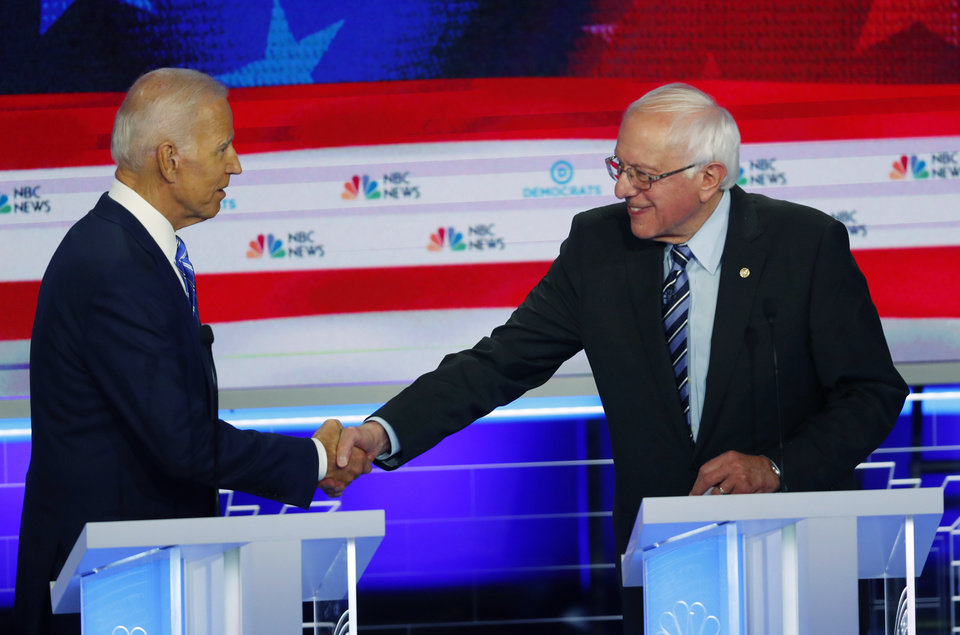 Photo - Democratic presidential candidate Sen. Bernie Sanders, I-Vt., shakes the hand former vice president Joe Biden at the end of the Democratic primary debate hosted by NBC News at the Adrienne Arsht Center for the Performing Arts, Thursday, June 27, 2019, in Miami. (AP Photo/Wilfredo Lee)