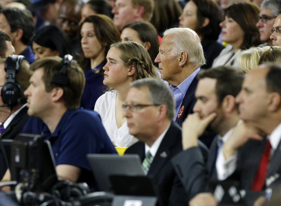 Photo - Vice President Joe Biden watches the national semifinal between the Oklahoma Sooners (OU) and the Villanova Wildcats in the Final Four of the NCAA Men's Basketball Championship at NRG Stadium in Houston, Saturday, April 2, 2016. Photo by Nate Billings, The Oklahoman