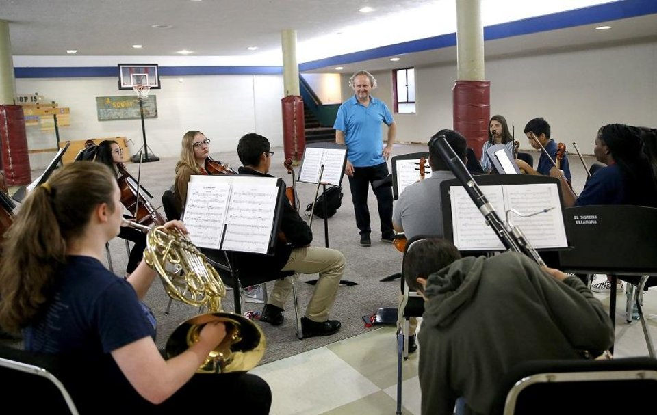 Photo - Jeffrey Grogan directs a rehearsal of La Sala Musical, an ensemble with El Sistema Oklahoma, at First Presbyterian Church of Oklahoma City in Oklahoma City, Thursday, Sept. 19, 2019. [Sarah Phipps/The Oklahoman]