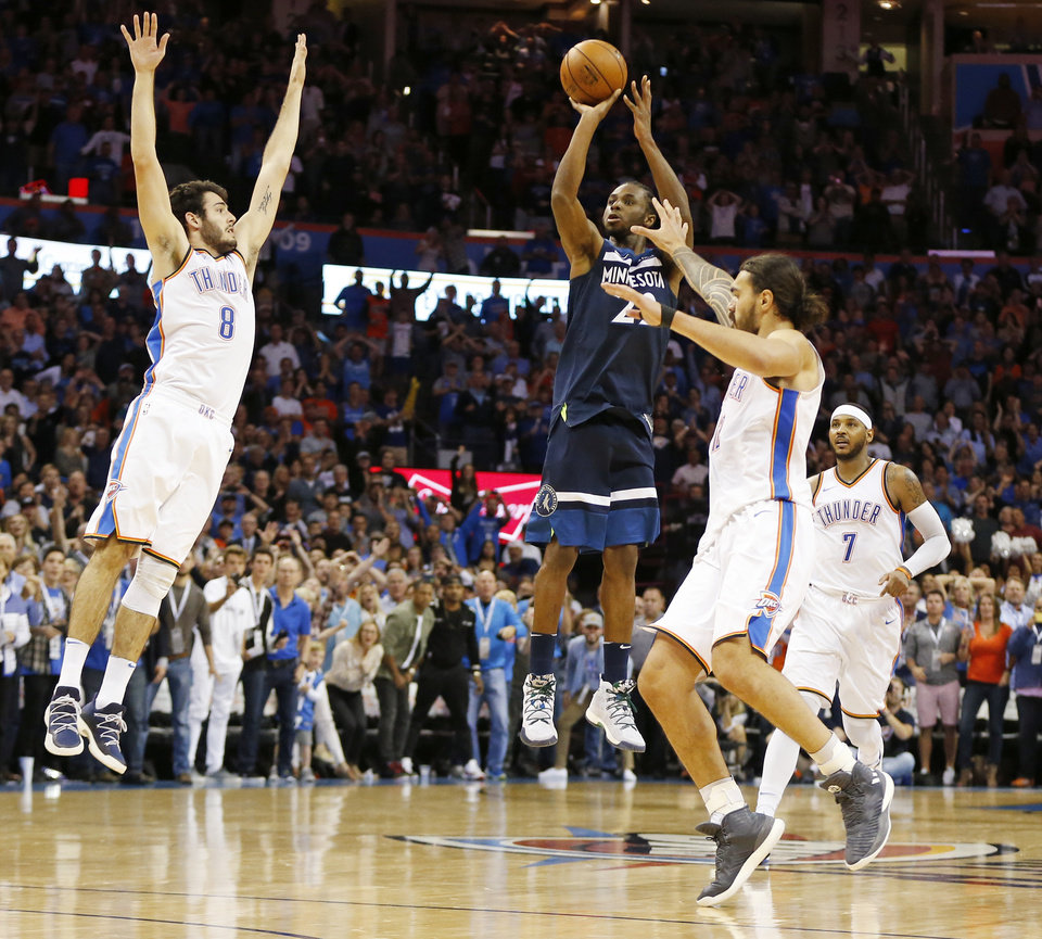 d37d43738e80 Minnesota s Andrew Wiggins (22) takes the game-winning shot as Oklahoma  City s Alex Abrines (8) and Steven Adams (12) defend in front of Carmelo  Anthony (7) ...