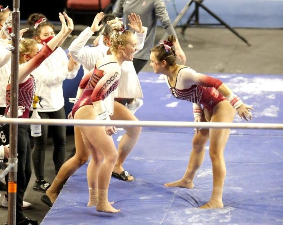 Photo -  OU's Karrie Thomas celebrates after the uneven bars during Sunday's gymnastics meet against Arizona State at Lloyd Noble Center in Norman. [Sarah Phipps/The Oklahoman]