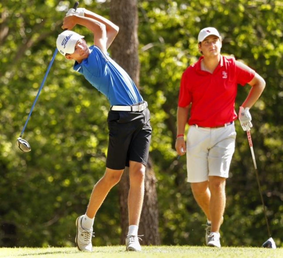 Photo -  Guthrie's Luke Morgan, left, tees off on the fifth hole during the final day of the Class 5Astate tournament last season. [OKLAHOMAN ARCHIVES]