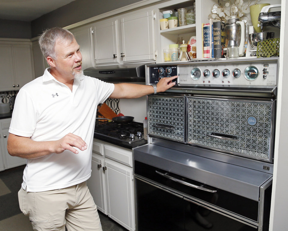 Photo -  Michael Hopkins, a collector of mid-century modern items, talks about his Frigidaire Flair Custom Imperial range at his home, 3704 Quapah Circle. Hopkins was vendor at the Mod Swap during Oklahoma Modernism Weekend in June. [PHOTO BY NATE BILLINGS, THE OKLAHOMAN ARCHIVES]