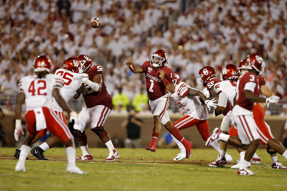 Photo - Oklahoma's Jalen Hurts (1) throws a pass during a college football game between the University of Oklahoma Sooners (OU) and the Houston Cougars at Gaylord Family-Oklahoma Memorial Stadium in Norman, Okla., Sunday, Sept. 1, 2019. Oklahoma won 49-31. [Bryan Terry/The Oklahoman]