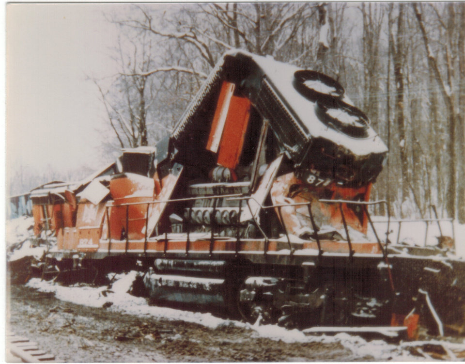 Photo -  The crumpled aftermath of the train accident in which Jim's father suffered severe injuries.