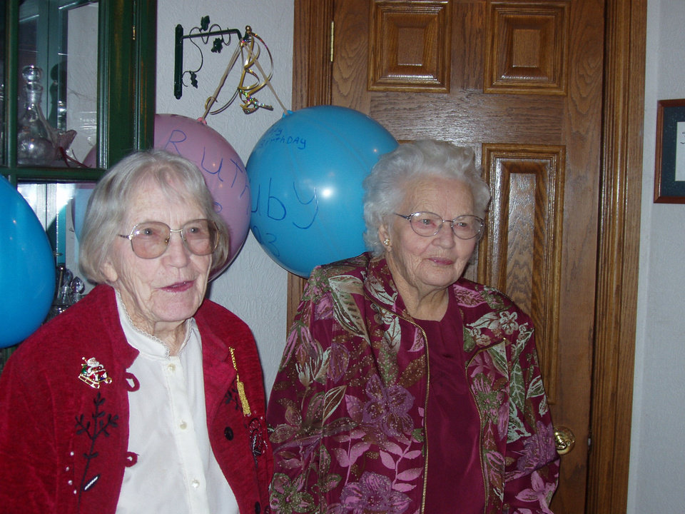 Photo - Ruby Woods  and Ruth Martin pose for a photo on their 99th birthday in 2012. The twins turned 100 on Dec. 9. Photo provided.
