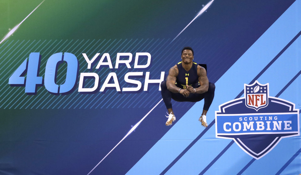 Photo - Oklahoma State running back Christopher Carson prepares to run the 40-yard dash at the NFL football scouting combine Friday, March 3, 2017, in Indianapolis. (AP Photo/David J. Phillip)