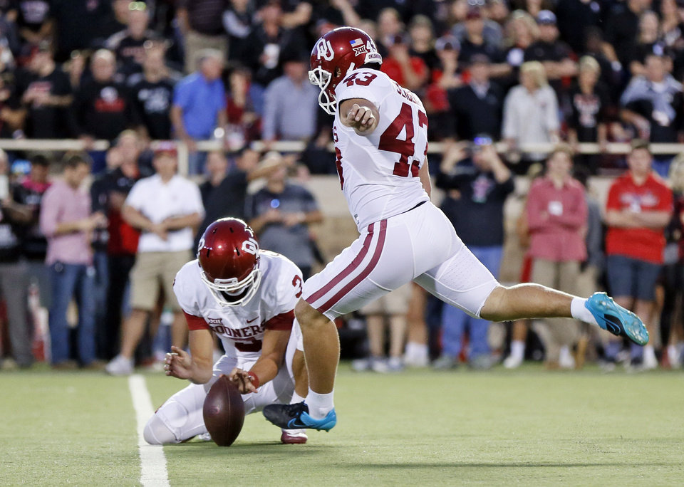 Photo - Oklahoma's Austin Seibert (43) attempts an extra point as Connor McGinnis (3) holds in the first quarter during a college football game between the University of Oklahoma Sooners (OU) and Texas Tech Red Raiders at Jones AT&T Stadium in Lubbock, Texas, Saturday, Oct. 22, 2016. The extra point was no good. Photo by Nate Billings, The Oklahoman