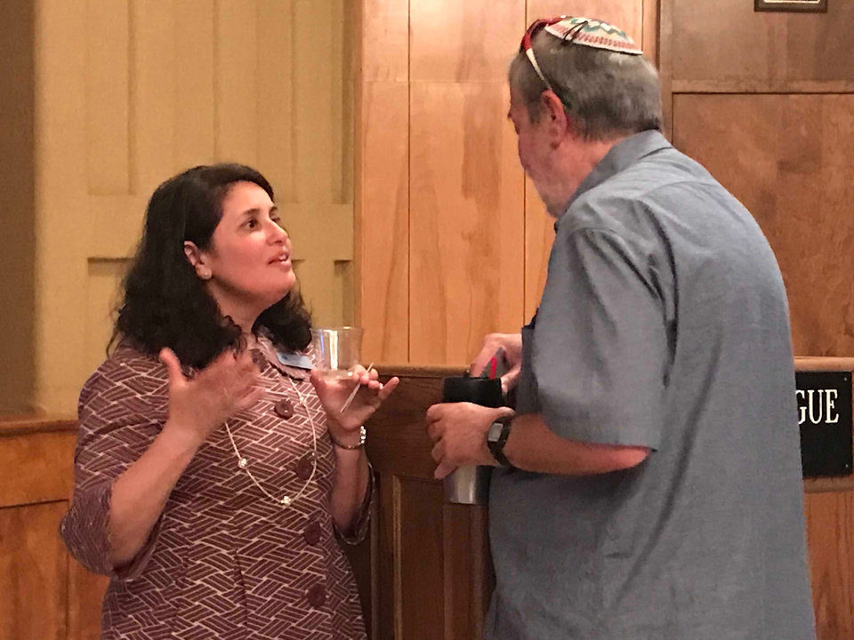 Photo -  Cheryl Drazin, regional director of the Anti-Defamation League, talks with  Edmond author Michael Korenblit, co-founder of the Respect Diversity Foundation, after Drazin's presentation at Emanuel Synagogue in Oklahoma City. [Photo by Carla Hinton, The Oklahoman]