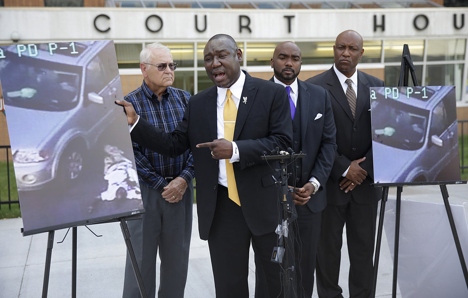 Photo - Attorney Benjamin Crump, center, one of the attorneys for Crutcher's family, speaks about Terence Crutcher during a news conference about the shooting death of Crutcher Tuesday, Sept. 20, 2016 in Tulsa, Okla. Crutcher, was shot by a Tulsa Police officer on Friday night. Also pictured are attorneys David Riggs, left, Damario Solomon-Simmons and Melvin C. Hall. (Mike Simons/Tulsa World via AP)