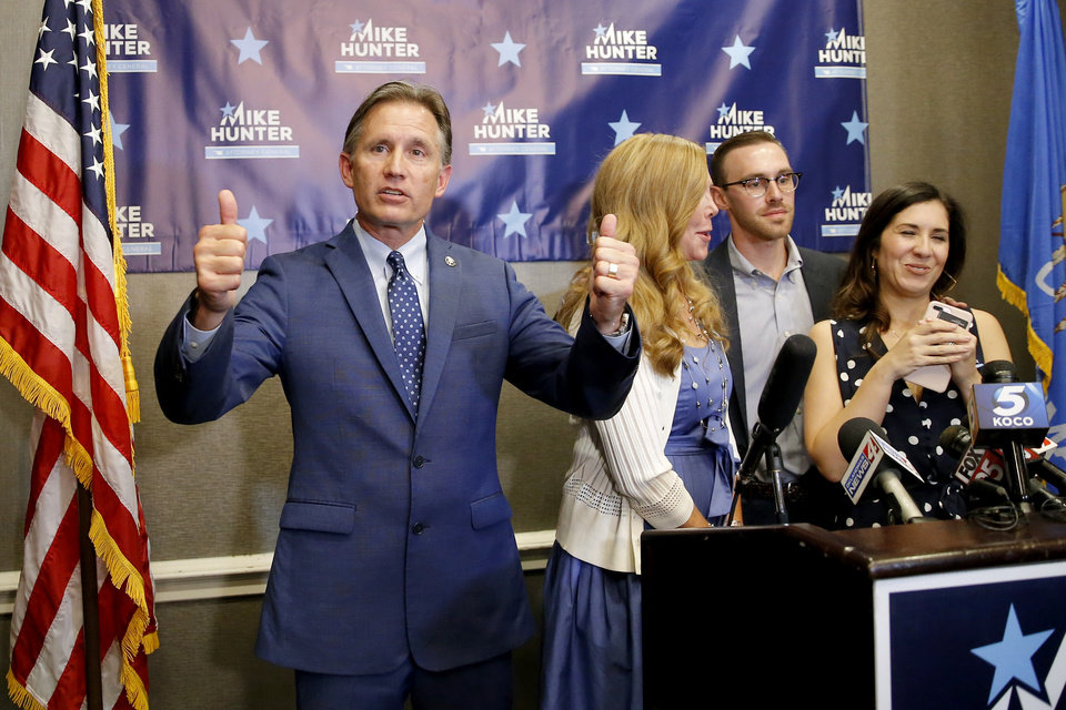 Photo - Attorney General Mike Hunter gestures to the crowd while speaking during his watch party in Nichols Hills, Okla., Tuesday, Aug. 28, 2018. Photo by Bryan Terry, The Oklahoman