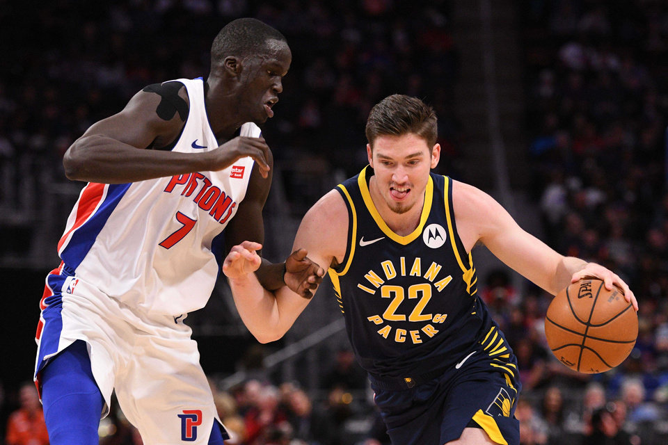 Photo - Apr 3, 2019; Detroit, MI, USA; Indiana Pacers forward T.J. Leaf (22) drives to the basket against Detroit Pistons forward Thon Maker (7) during the second quarter at Little Caesars Arena. Mandatory Credit: Tim Fuller-USA TODAY Sports