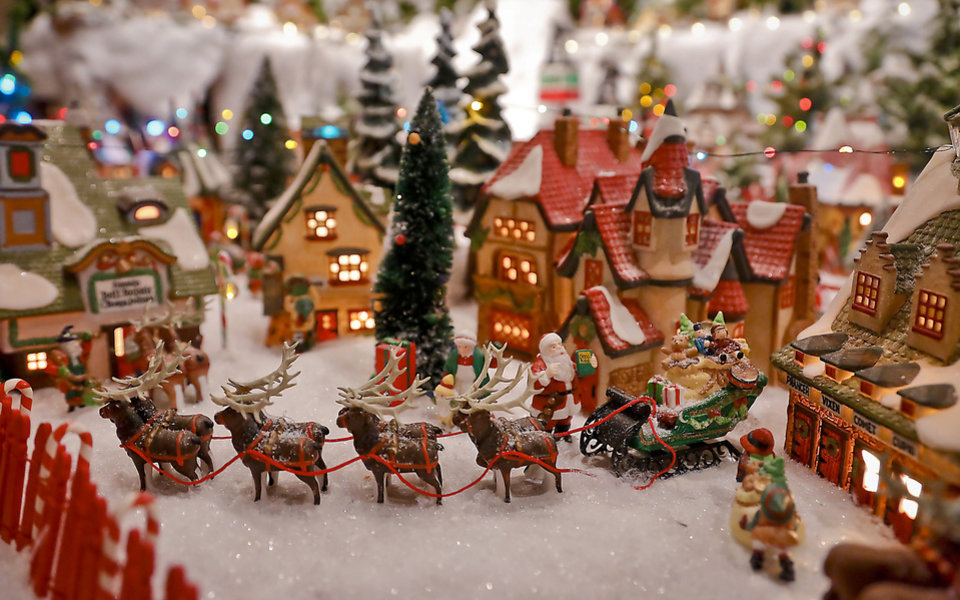 photo areas of the miniature christmas village that is set up in the three car