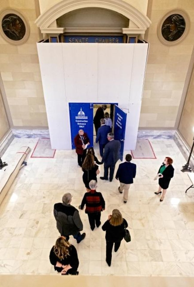 Photo -  Family members file into the Senate Chamber for the swearing in ceremony for new and re-elected Oklahoma senators at the Oklahoma state Capitol in Oklahoma City, Okla. on Monday, Nov. 16, 2020. [Chris Landsberger/The Oklahoman]