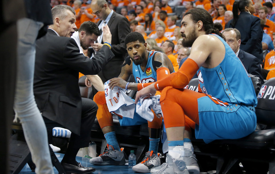 Photo - Oklahoma City coach Billy Donovan talks with Steven Adams (12) and Paul George (13) during Game 3 in the first round of the NBA playoffs between the Portland Trail Blazers and the Oklahoma City Thunder at Chesapeake Energy Arena in Oklahoma City, Friday, April 19, 2019. Oklahoma City won 120-108. Photo by Bryan Terry, The Oklahoman