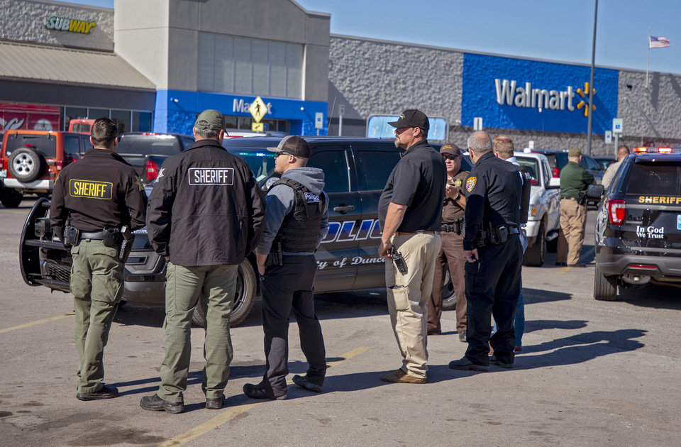 Photo - Authorities work the scene of a shooting that left three people dead in the Walmart parking lot in Duncan, Okla. on Monday, Nov. 18, 2019.   [Chris Landsberger/The Oklahoman]