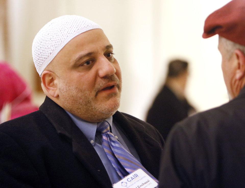 Photo - Dr. Imad Enchassi speaks to another participant as CAIR and local Muslims gather at the State Capitol in Oklahoma City, OK, for Oklahoma Muslim Day, Friday, February 27, 2015,  Photo by Paul Hellstern, The Oklahoman