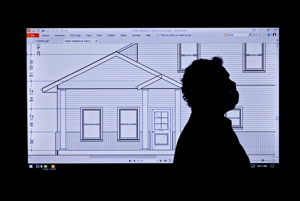 Photo -  Clients experience the layout of their new home as they interact with projected life-size blueprints at Projected Plans in Norman. [CHRIS LANDSBERGER/THE OKLAHOMAN]