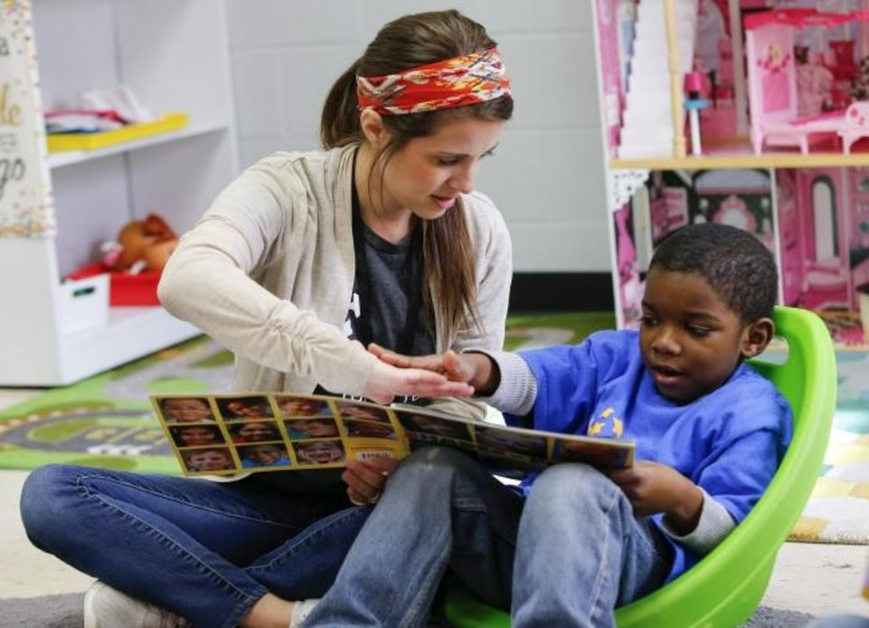 Photo -  Pre-k teacher KayLeigh Brosh works with Ka'Myrion, 4, at Positive Tomorrows school for homeless children in Oklahoma City, Wednesday, Jan. 23, 2019. Photo by Nate Billings, The Oklahoman