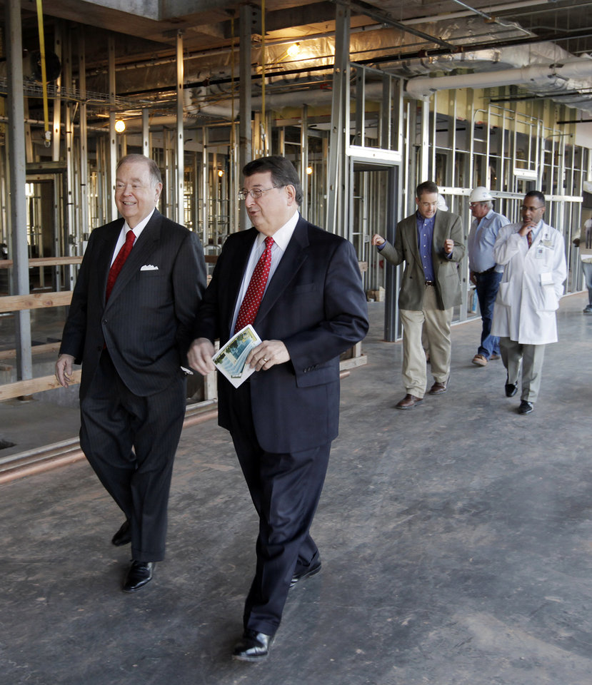 Photo - DAVID BOREN: OU President David L. Boren, left, walks with M. Dewayne Andrews, M.D., Executive Deean and Vice President for Health Affairs, as they tour the construction of the OU Cancer Institute during the Midpoint Milestone Celebration for the OU Cancer Institute Building, Tuesday, Nov. 3, 2009. Photo by Nate Billings, The Oklahoman ORG XMIT: KOD