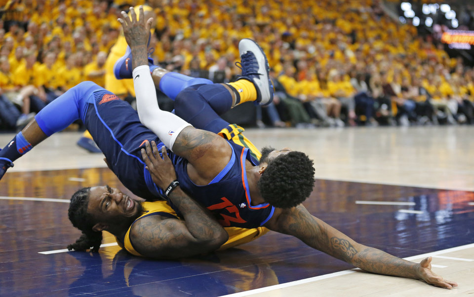 Photo - Utah Jazz forward Jae Crowder, bottom, fouls Oklahoma City Thunder forward Paul George during the first half of Game 6 of an NBA basketball first-round playoff series Friday, April 27, 2018, in Salt Lake City. (AP Photo/Rick Bowmer)