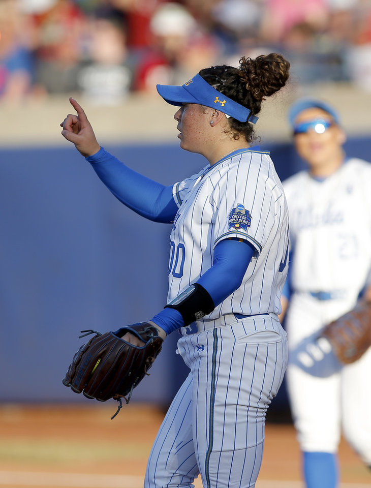 Photo - UCLA's Rachel Garcia (0) celebrates a strke out in the 1st inning during the second NCAA softball game in the championship series of the Women's College World Series between Oklahoma and UCLA at USA Softball Hall of Fame Stadium in Oklahoma City, Tuesday, June 4, 2019. [Sarah Phipps/The Oklahoman]