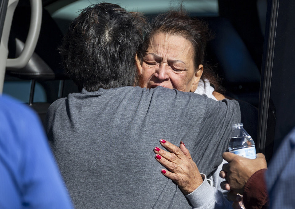 Photo - A family member reacts at the scene of a shooting that left three people dead in the Walmart parking lot in Duncan, Okla. on Monday, Nov. 18, 2019.   [Chris Landsberger/The Oklahoman]