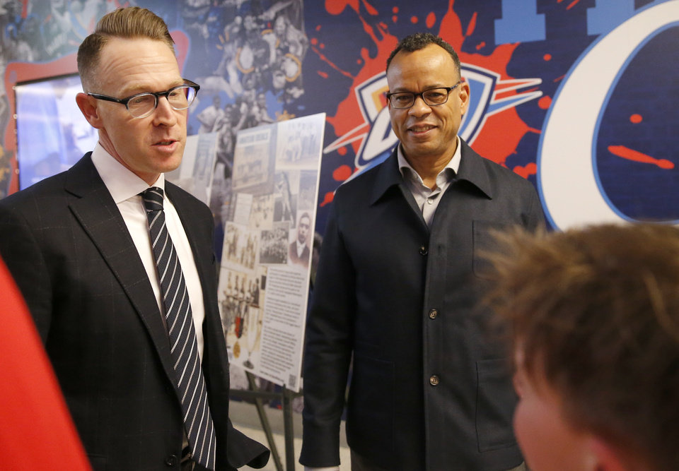 Photo - Claude Johnson, executive director of Black Fives Foundation, and Sam Presti talk with fans before the NBA game between the Oklahoma City Thunder and the Utah Jazz at the Chesapeake Energy Arena, Friday, Feb. 22, 2019. Photo by Sarah Phipps, The Oklahoman