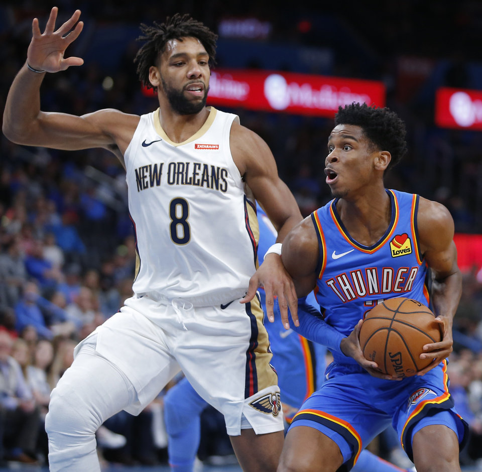 Photo - Oklahoma City's Shai Gilgeous-Alexander (2) goes past New Orleans' Jahlil Okafor (8) during an NBA basketball game between the Oklahoma City Thunder and the New Orleans Pelicans at Chesapeake Energy Arena in Oklahoma City, Saturday, Nov. 2, 2019. Oklahoma City won 115-104. [Bryan Terry/The Oklahoman]