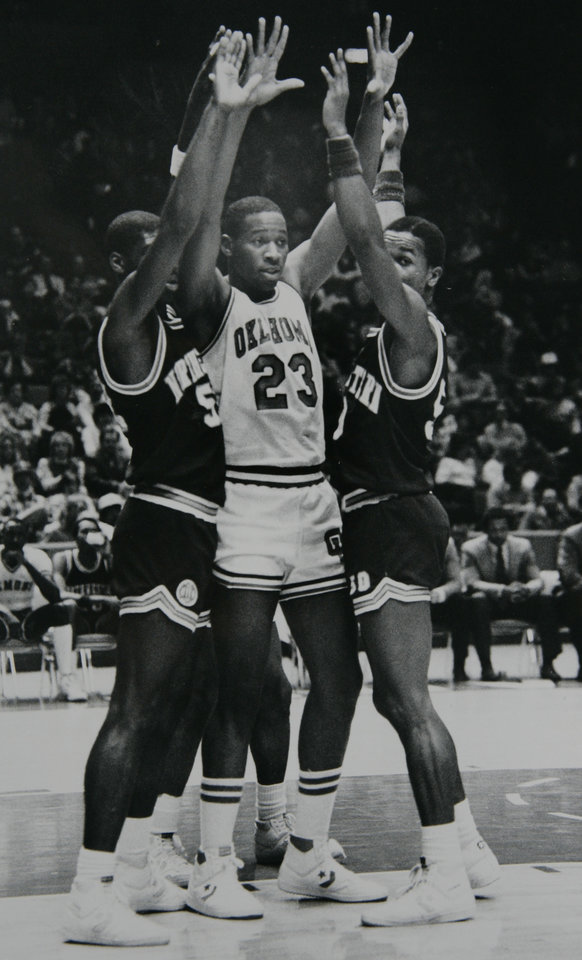 Photo - Former OU basketball player Wayman Tisdale. OU's Wayman Tisdale has the upper hand on the Northwestern Louisiana defense Saturday. Staff photo by George R. Wilson. Photo taken 1/12/1984, photo published 1/13/1984  in The Daily Oklahoman. ORG XMIT: KOD