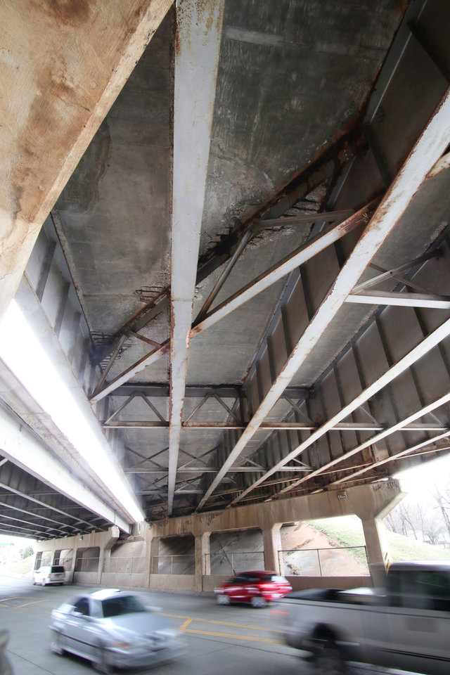 Photo -  The underside of the I-40 bridge that crosses SE 15th Street shows the amount of repairs it has had over the years, Monday, March 2, 2020.  [Photo by Doug Hoke/The Oklahoman]