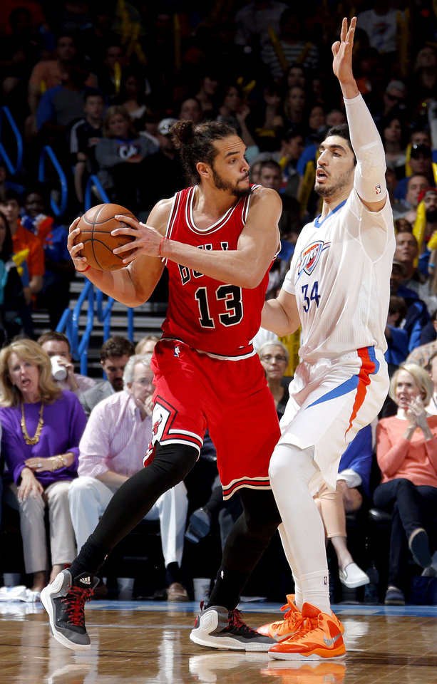 Photo - Oklahoma City's Enes Kanter (34) defends against Chicago's Joakim Noah (13) during the NBA game between the Oklahoma City Thunder and the Chicago Bulls at Chesapeake Energy Arena in Oklahoma City, Sunday, March  15, 2015. Photo by Sarah Phipps, The Oklahoman