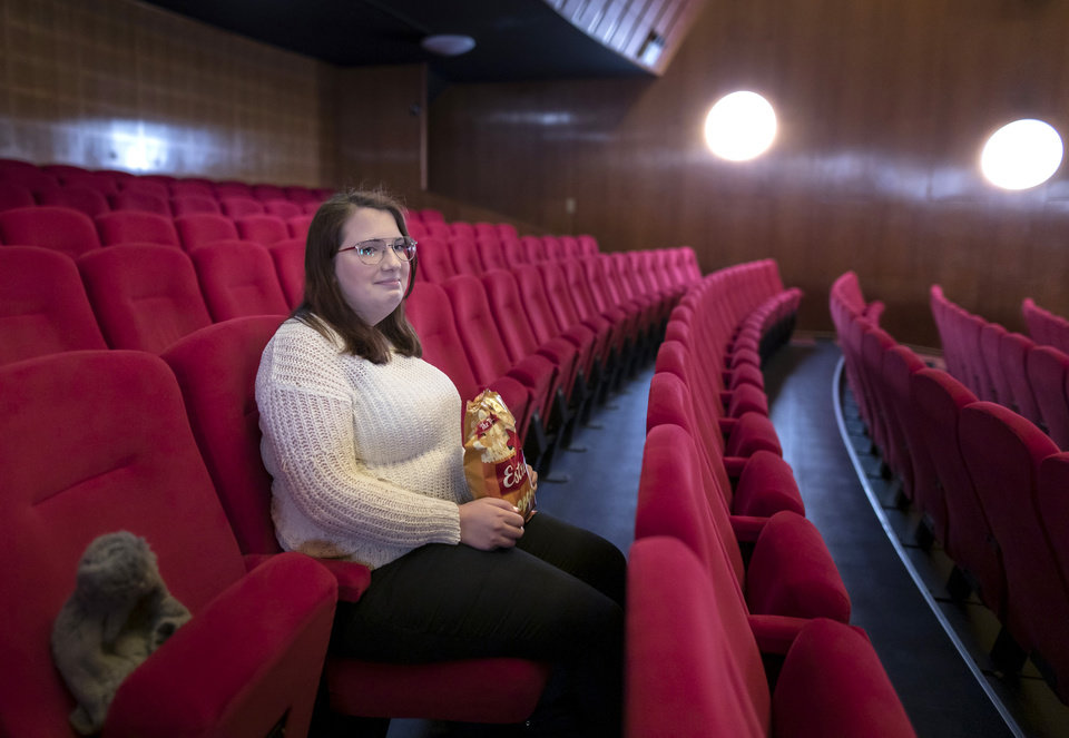 Photo -  Malin Hellberg, sits alone to watch the film Tigrar, in Gothenburg, Sweden, on Saturday, Jan. 30, 2021. The 44th Goteborg film festival opened this weekend in a mostly virtual format. For the real world movie experience, a lottery determines who gets the one ticket for the 700-seat cinema. (AP Photo/Thomas Johansson)