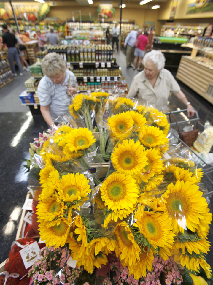 Photo -  Even sunflowers are sold at the new Sunflower Farmers Market grocery store in Oklahoma City, OK, Tuesday, Aug. 30, 2011. By Paul Hellstern, The Oklahoman