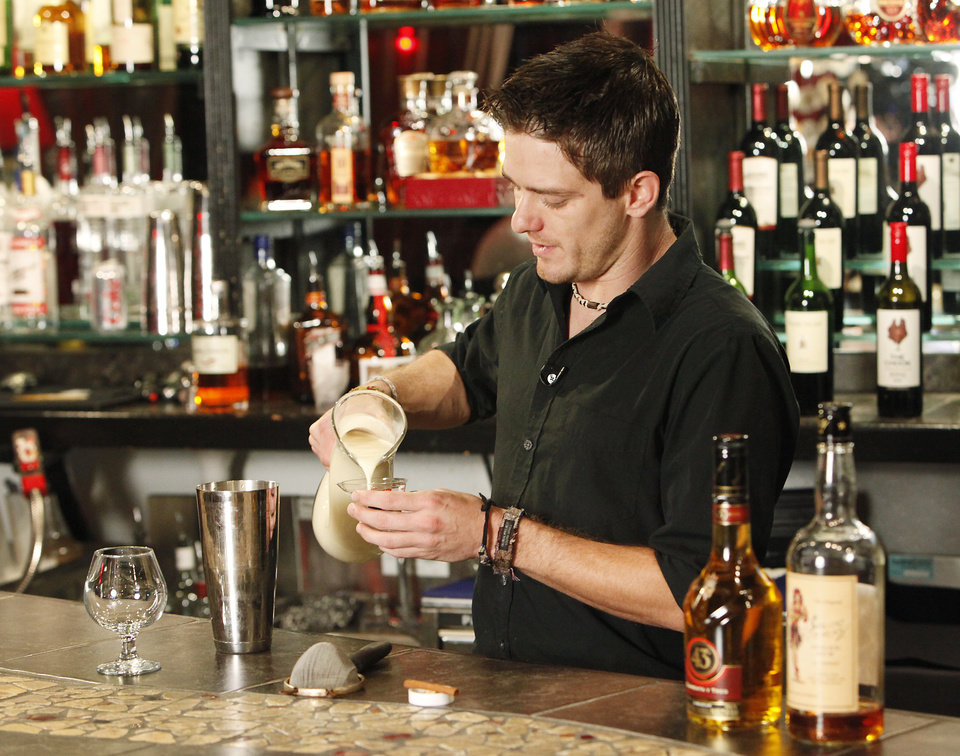 Photo -  Hot drinks, Scott Glidwell the bartender at Paseo Grill  stirs up a classic Eggnog, Monday, November 29, 2010.  Staff photo by David McDaniel/The Oklahoman