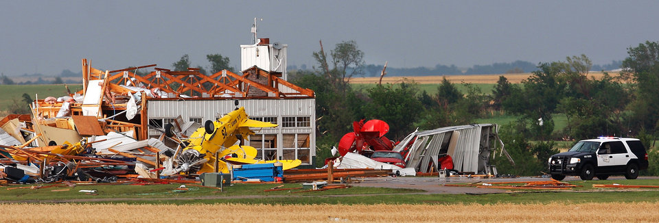 Photo - Upended small aircraft are strewn about this destroyed airplane hangar east of SH 74, east of Cashion. after a tornado came through the area Tuesday afternoon,  May 24, 2011,   Photo by Jim Beckel, The Oklahoman