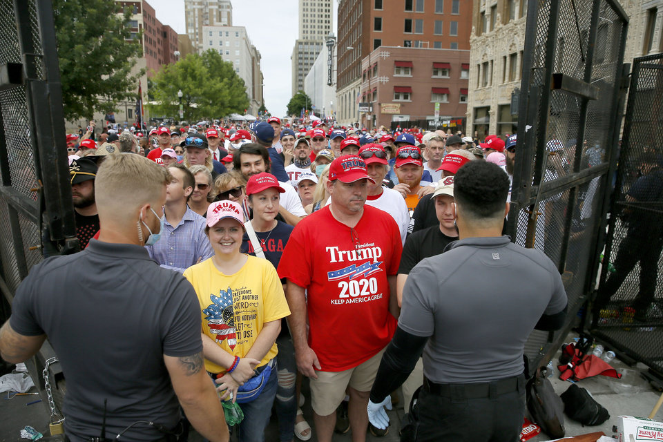 Photo - President Donald Trump supporters wait to be let through a barricade before a rally at the BOK Center in Tulsa, Okla., Saturday, June 20, 2020. [Bryan Terry/The Oklahoman]