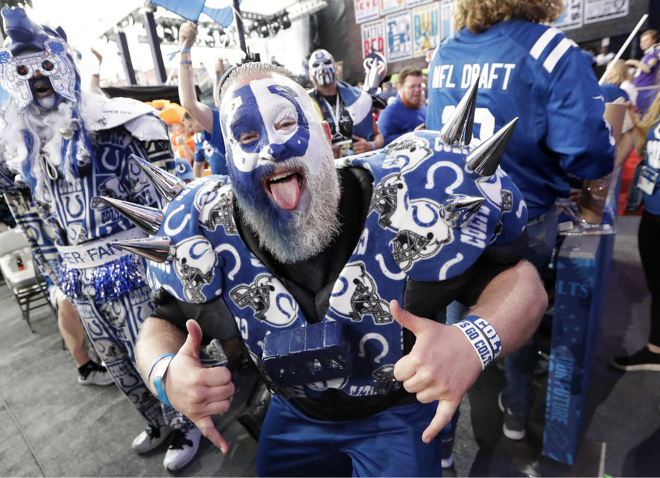 Photo - A Indianapolis Colts fan cheers ahead of the first round at the NFL football draft, Thursday, April 25, 2019, in Nashville, Tenn. (AP Photo/Mark Humphrey)