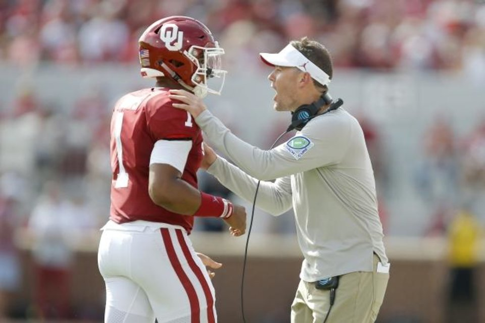 Photo -  Oklahoma's Jalen Hurts (1) talks with coach Lincoln Riley during a college football game between the University of Oklahoma Sooners (OU) and Texas Tech University at Gaylord Family-Oklahoma Memorial Stadium in Norman, Okla., Saturday, Sept. 28, 2019. [Bryan Terry/The Oklahoman]